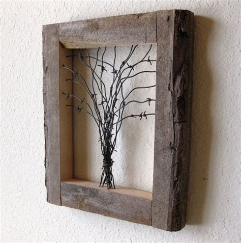 finding the artistic barn wood reclaimed barn wood and barbed wire tree wall