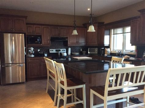 how to lighten dark cabinets without painting dark kitchen need to lighten up without painting out