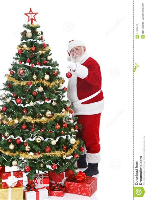 santa claus decorating christmas tree stock photo image