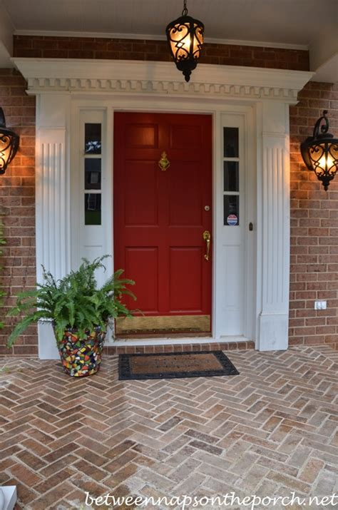 brick house with kelly moore red door paint your front door red