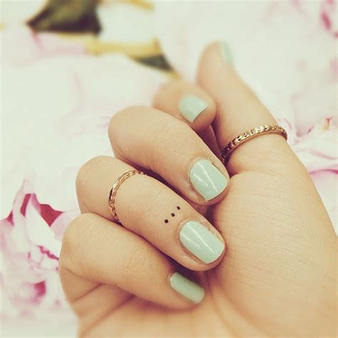 3 dots finger tattoo