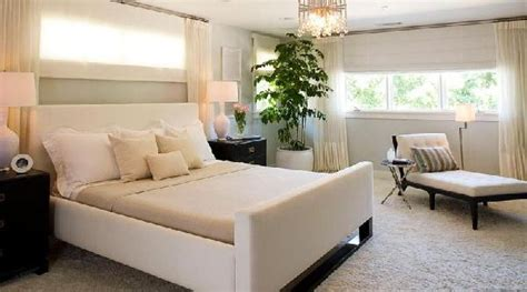 bed under window bed under window transitional bedroom brown design