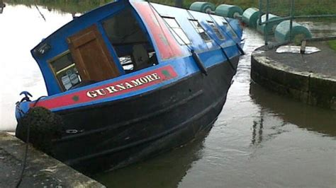 a boat operating in a narrow channel narrow boat sinks anglia itv news