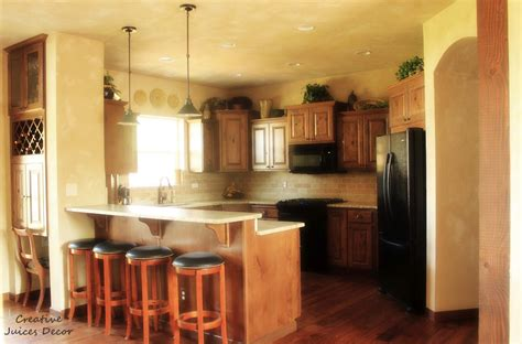 Decorating Tops Of Kitchen Cabinets by Creative Juices Decor Decorating The Top Of Your Kitchen