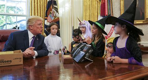 trump hosts white house reporters kids for oval office trick or trump us president s cringeworthy meeting with