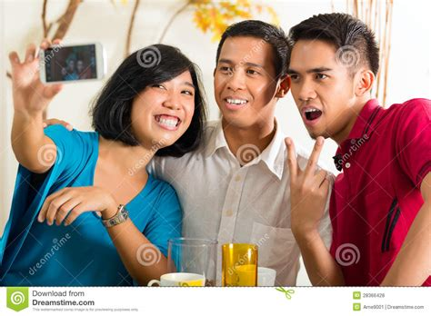 asian friends  pictures  mobile phone royalty  stock  image