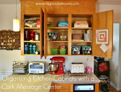 organizing cabinets in kitchen organizing kitchen cabinets with a cork message center