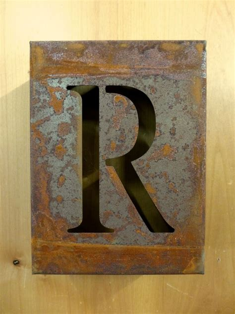 rusty rusted industrial metal block cut sign letter