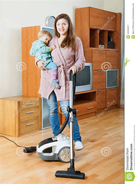 Vacuum The Living Room In Cleaning Living Room With Vacuum Cleaner Stock Photo