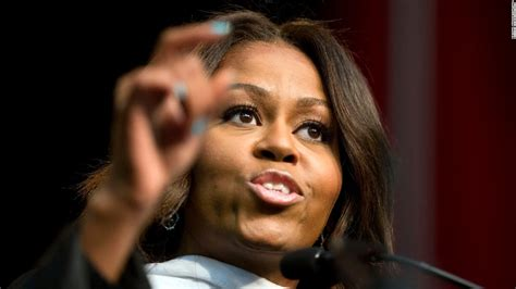 michelle obama verizon center audience served arrest warrants for graduation cheering cnn