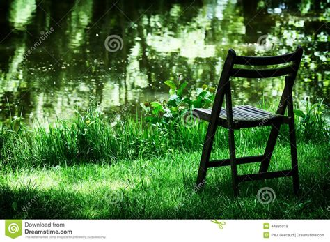 Garden Chair Of Solitude by Lonely Chair In Garden Stock Image Image Of Field