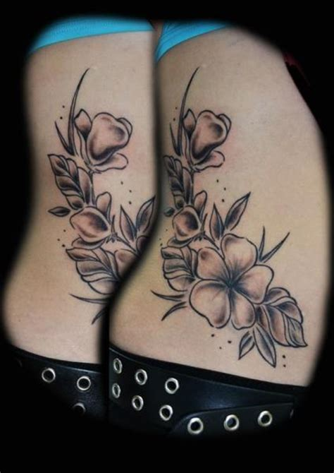 flower side tattoo by die stichelei