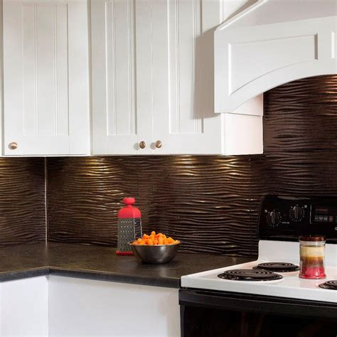 faux kitchen backsplash fasade 24 in x 18 in waves pvc decorative tile backsplash in smoked pewter b65 27 the home depot