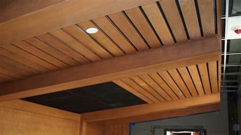 closet closet with wood ceiling beams beams ceiling light