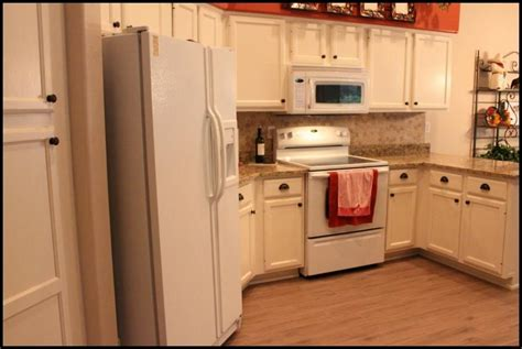 photos of before and after refinished kitchen cabinets