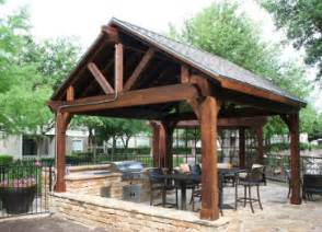 pitched and shingled covered arbor roofed arbor patio