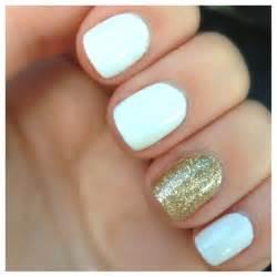 White and gold nailsholiday nails gold nails gold sparkle nails