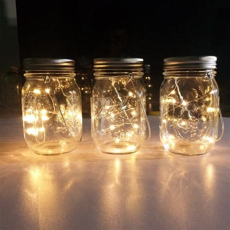 Mason Jar Centerpieces: Floating Candles   Emmaline Bride