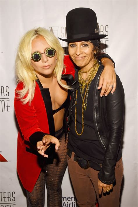lady gaga accepts contemporary icon award in bra and linda perry questions lady gaga s oscar song credit