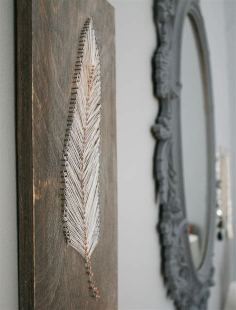 String Feather - nail and string feather wall hanging decor hacks