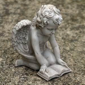 small cherub reading book garden ornament angel cherubs