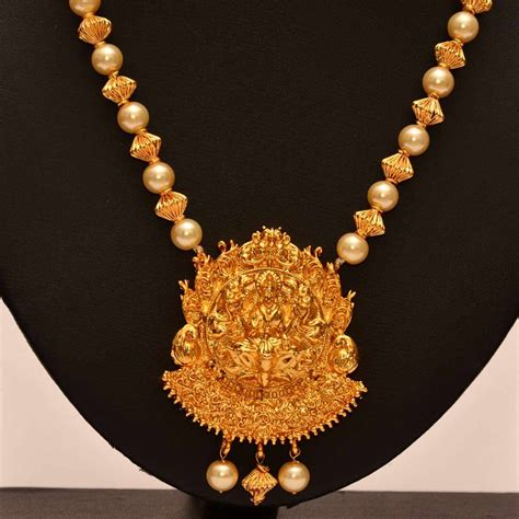 pearls with gold anvi s lakshmi temple jewellery pendent with gold toned