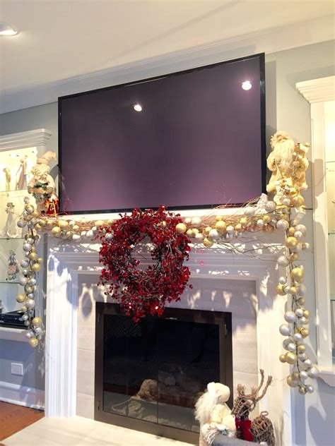 mantle decoration for christmas with a big screen tv