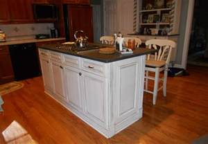 kitchen cabinet island with white color and black top