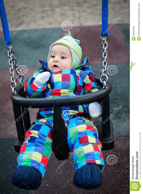 boy baby swing baby boy sitting in a swing stock photo image 40676709