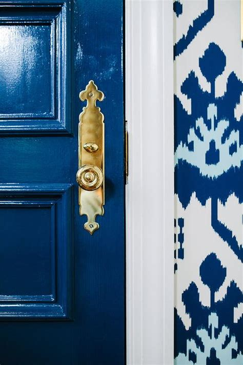 glossy blue front door  brass door handle transitional entrancefoyer