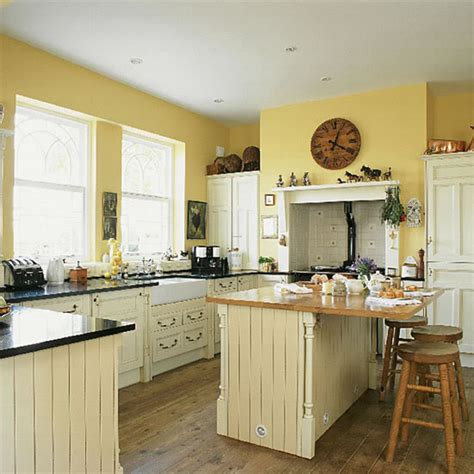 yellow kitchen with white cabinets how about yellow cabinets bad for resale design