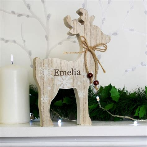 rustic decorations uk personalised rustic wooden reindeer decoration