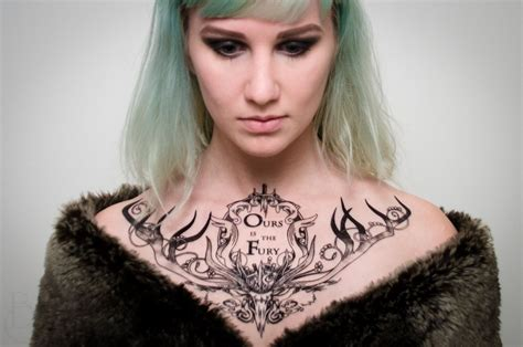 female chest tattoo fancy house of baratheon chest proper ink