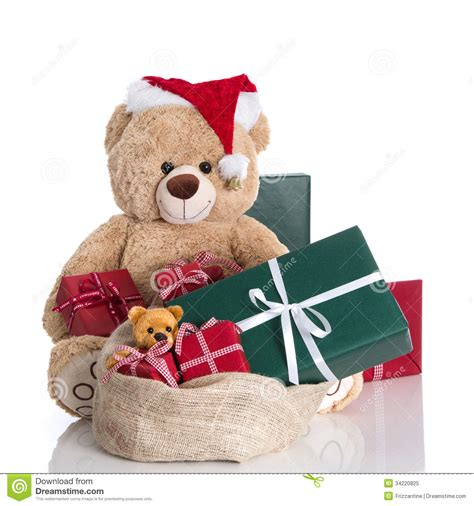 teddy bear wearing christmas hat with gifts isolated on