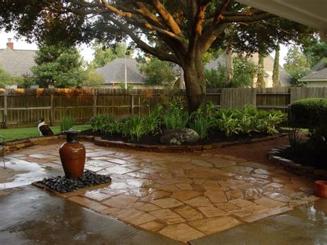 landscaping a large backyard this backyard landscaping centered around a large oak tree