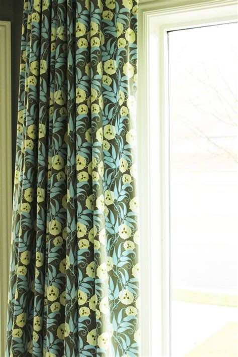 hanging valances over curtains how to hang curtains a basic guide