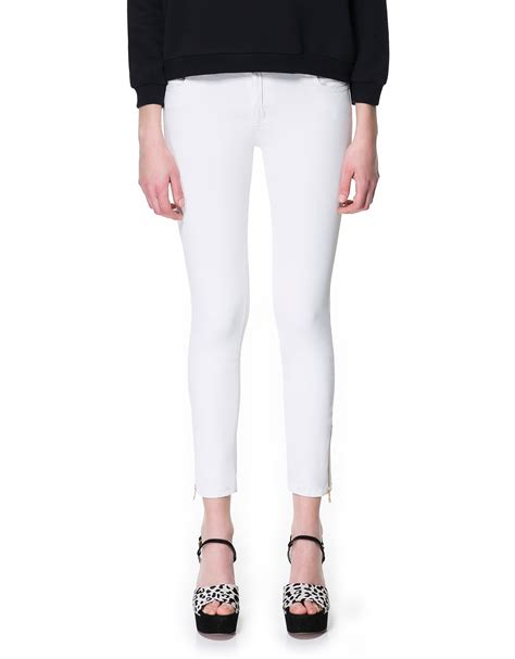 zara trousers with zips in zara coated trousers with zips in white lyst