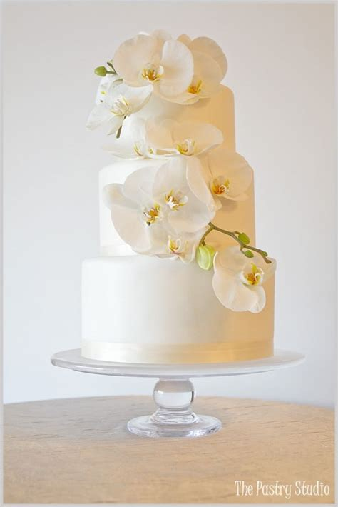 Hochzeitstorte Orchidee by A Classic White Shimmered Wedding Cake Adorned With