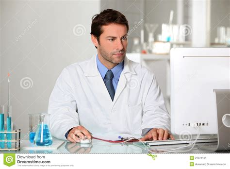 Photo Lab Technician by Lab Technician Studying Results On A Computer Stock Image Image 21371191