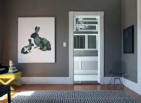 Heavy charcoal walls outlined in gray trim gray on gray a classy