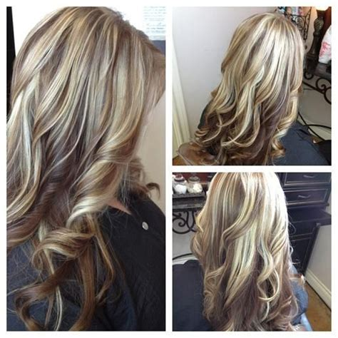 long blonde hair with dark low lights long blonde hair with red lowlights loosely curled