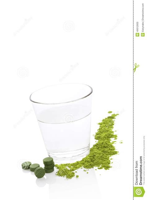 Chlorella For Mold Detox by Green Food Supplements And A Glass Of Water Stock Photo
