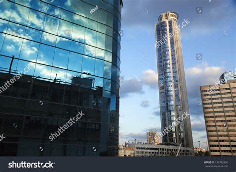 skyscraper curtains tall skyscraper raising behind part of an office building