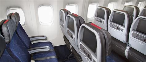 united airlines comfort seats american cutting legroom in economy class will united