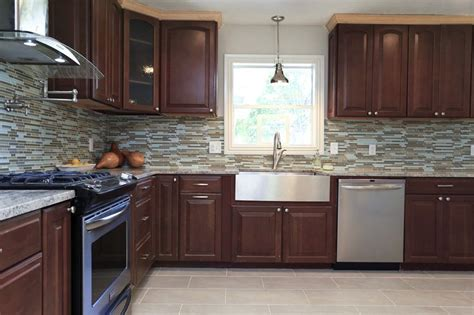 stone accent wall kitchen farmhouse with kitchen sink in cherry cabinets with mosaic glass and stone backsplash