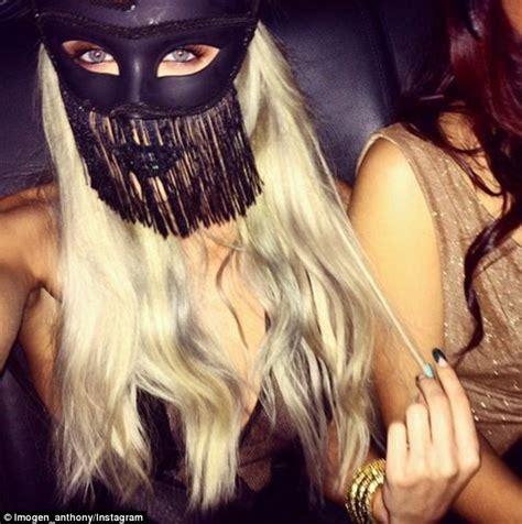 imogen anthony wears black mask and sking tight gown for