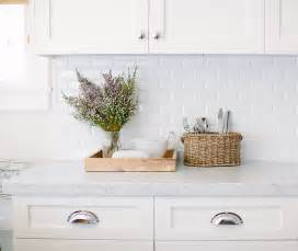 carrara marble subway tile kitchen backsplash inspiring white kitchen with light blue island home