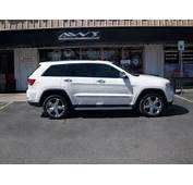 White 2012 Jeep Grand Cherokee With Factory Chrome Wheels Wrapped In