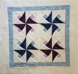 pinwheel quilt block pattern folded catherdral style