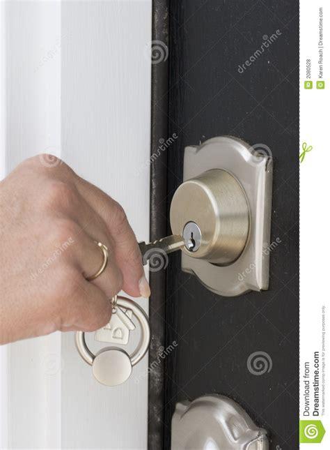 Unlock The Front Door Unlocking The Door Royalty Free Stock Photos Image 2080528